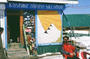 Local ski-guide ''Willy'' relaxing in front of the heart and soul of Gulmarg, the Kashmir Alpine Ski Shop.       Photo: Ptor Spricenieks, skiherenow@yahoo.com